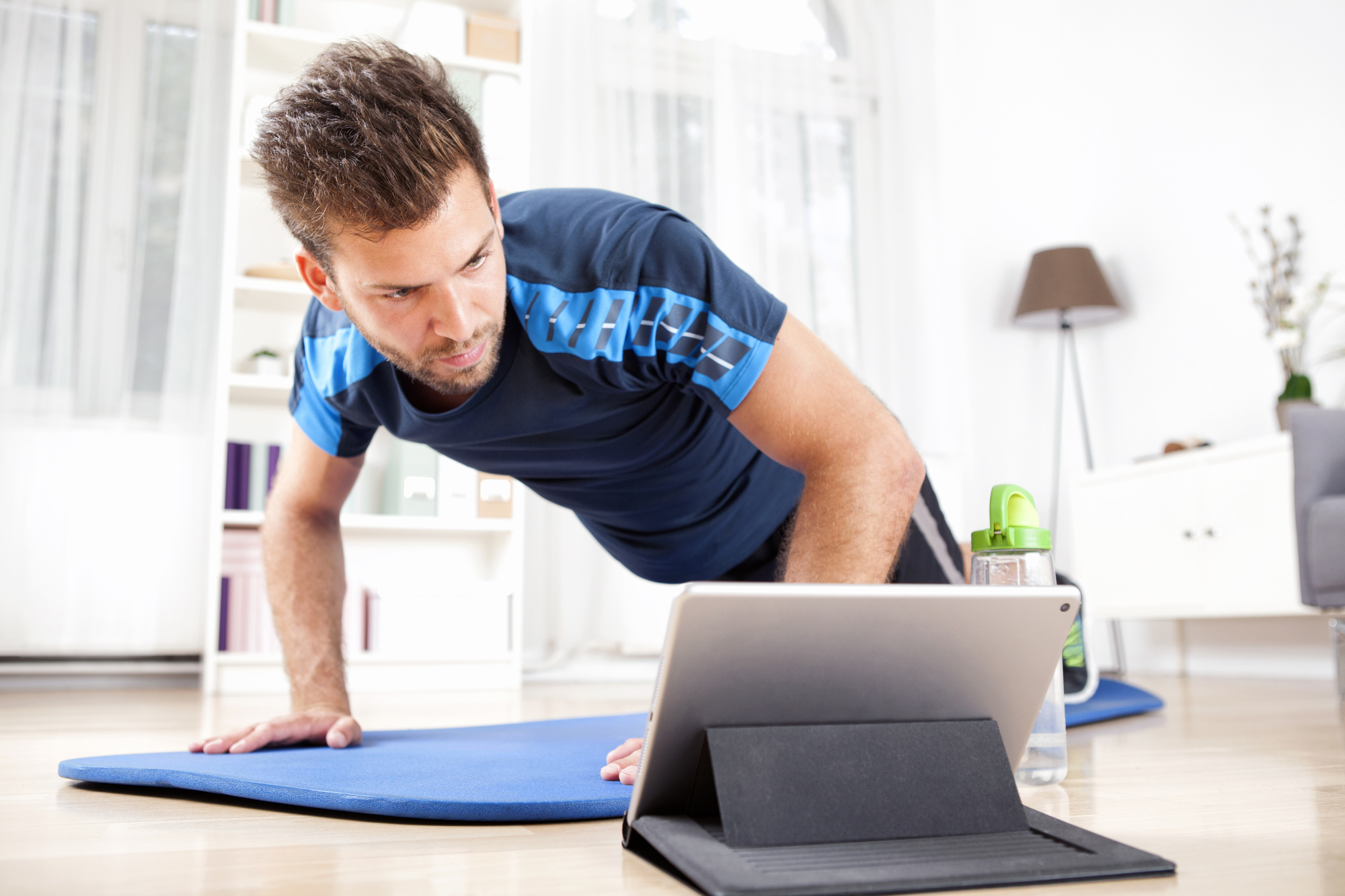 man doing online workout