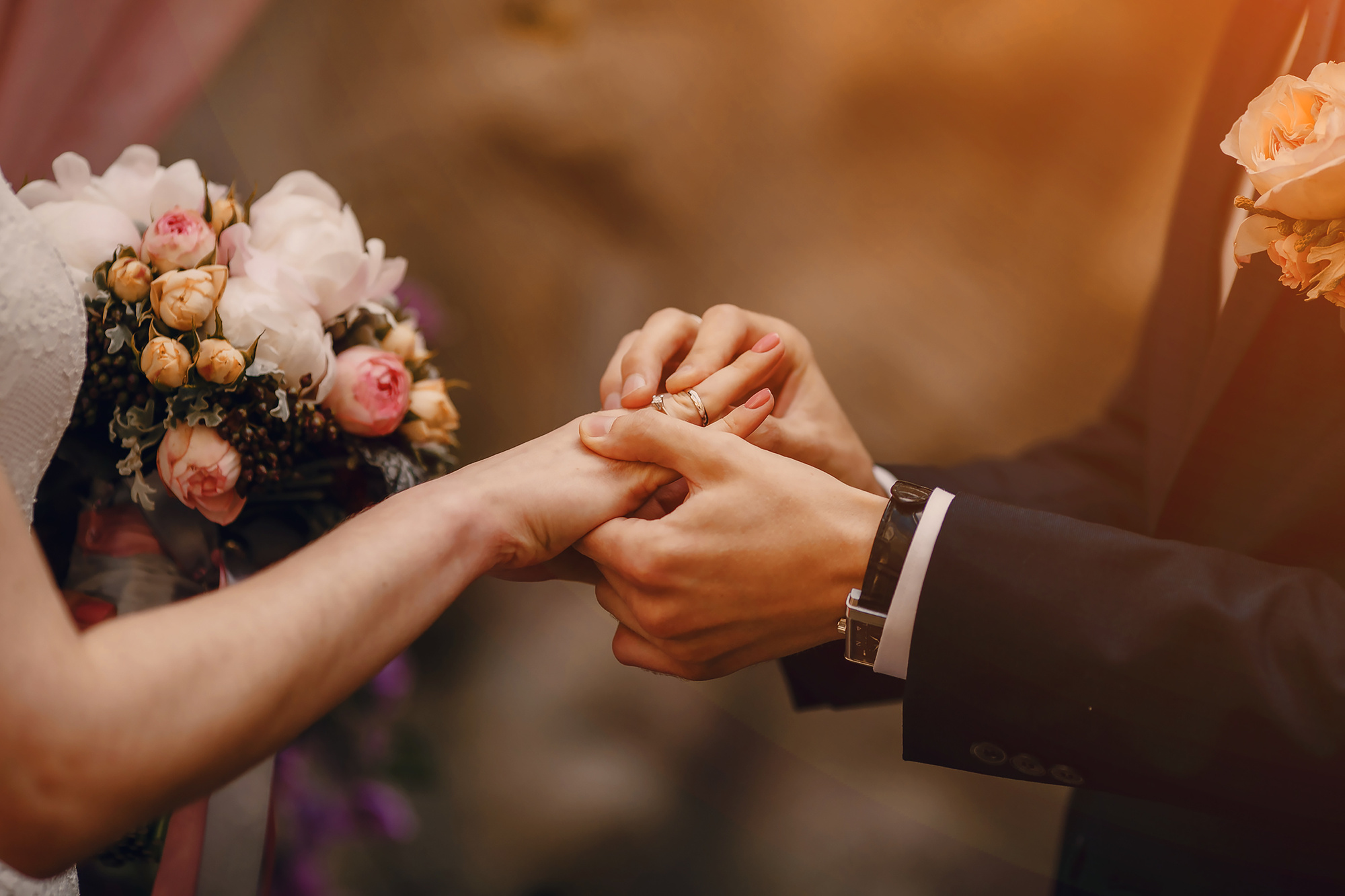 wedding ring and bride and groom