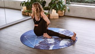 woman on yoga mat meditating