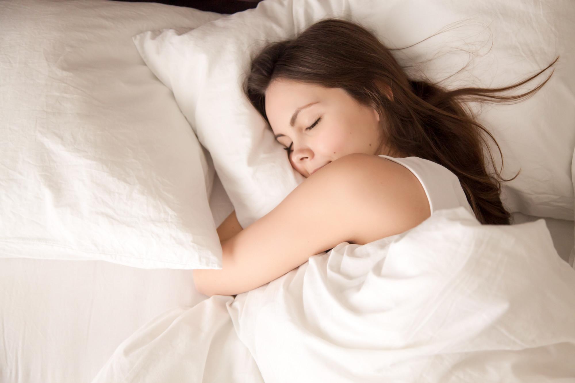 woman getting healthy sleep